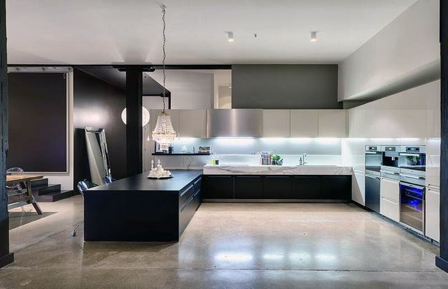 Black-Kitchen-Countertop-with-Polished-Concrete-Floors